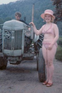 Kathy in a rare bikini shot - with tractor !